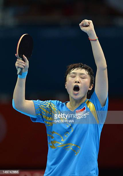 Feng Tianwei of Singapore celebrates her vital point against Poland's Li Qian during a table tennis women's team match of the London 2012 Olympic...
