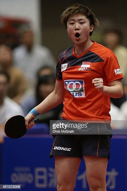 Feng Tianwei of Singapore celebrates winning a point against Ishikawa Kasumi of Japan during the Women's Singles Final against Feng Tianwei of...