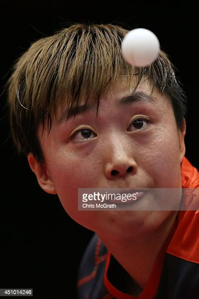 Feng Tianwei of Singapore serves against Li Fen of Sweden during their Women's Singles Semi final match on day three of 2014 ITTF World Tour Japan...