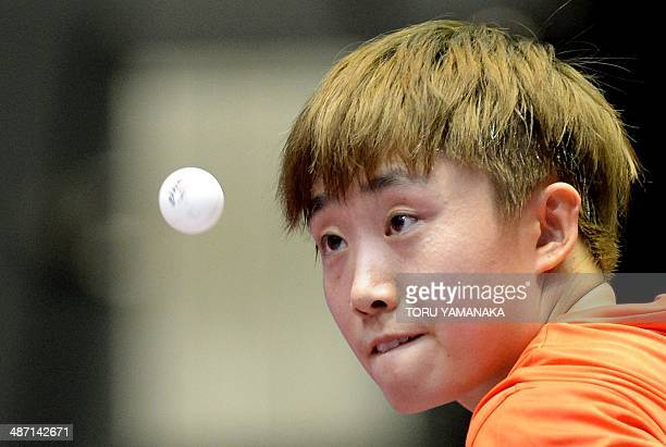 Feng Tianwei of Singapore serves against Sarah De Nutte of Luxembourg at the 2014 World Team Table Tennis Championships in Tokyo on April 28 2014 AFP...
