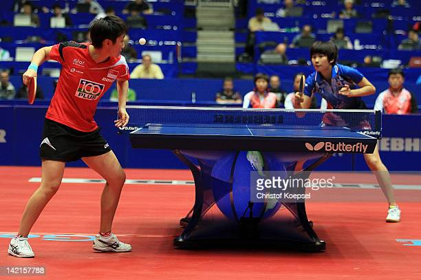 Feng Tianwei of Singapore serves during her match against Seok Ha Jung of South Korea during the LIEBHERR table tennis team world cup 2012...