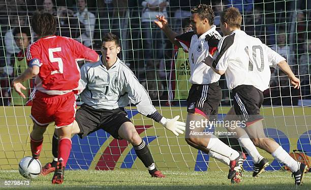 Feng Xiaoting of China shoots past Goalkeeper Philipp Tschauner of Germany during the match between Germany and China in the men's under 20's...