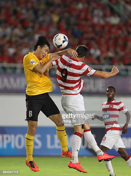 Feng Xiaoting of Guangzhou Evergrande in action with Tomi Juric of Western Sydney Wanderers during the Asian Champions League Quarter Final match...