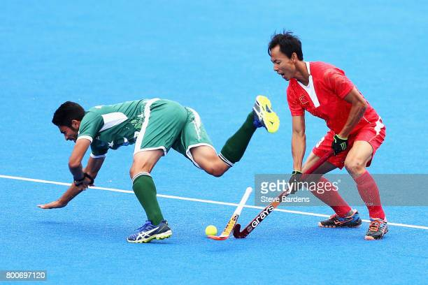 Fenghui Lu of China fouls Abu Mahmood of Pakistan during the 7th/8th place match between Pakistan and China on day nine of the Hero Hockey World...