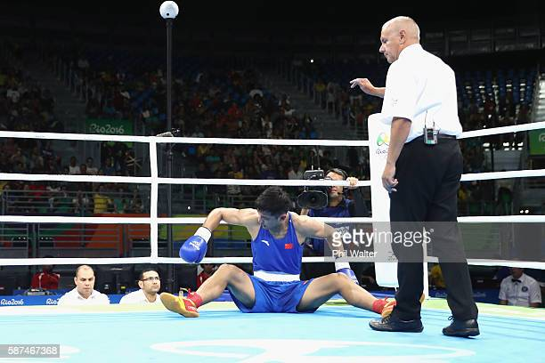 Fengkai Yu of China is knocked down by Vassiliy Levit of Kazakhstan in their Mens 91kg Heavyweight bout on Day 3 of the Rio 2016 Olympic Games at the...