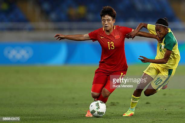 Fengyue Pang of China battles for the ball with Linda Motlhalo of South Africa during the Women's Group E first round match between South Africa and...
