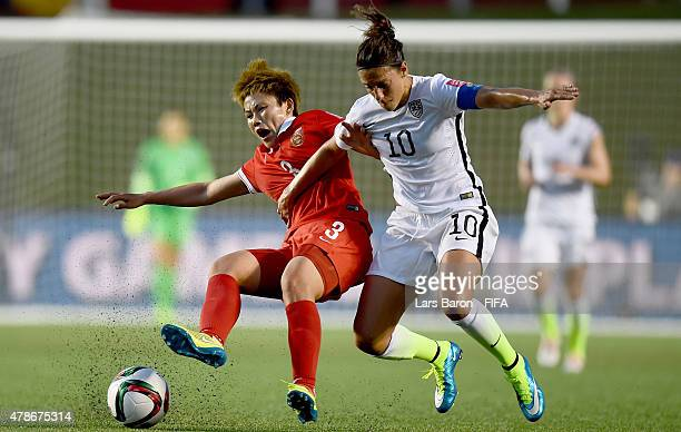 Fengyue Pang of China is challenged by Carli Lloyd of USA during the FIFA Women's World Cup 2015 Quarter Final match between China and United States...