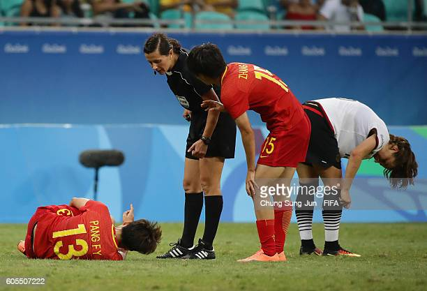 Fengyue Pang of China is injured during the Women's Football Quarter Final match between China and Germany on Day 7 of the Rio 2016 Olympic Games at...