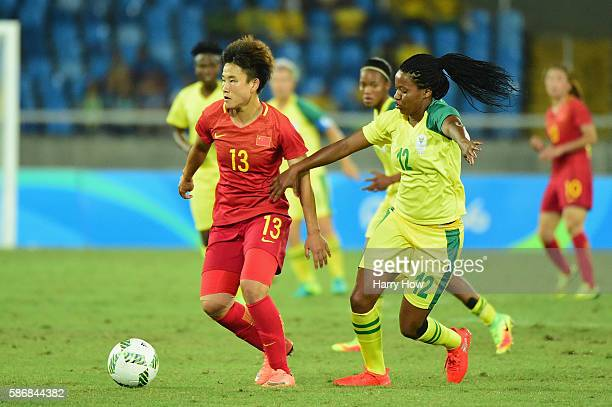 Fengyue Pang of China runs with the ball during the Women's Group E first round match between South Africa and China PR on Day 1 of the Rio 2016...