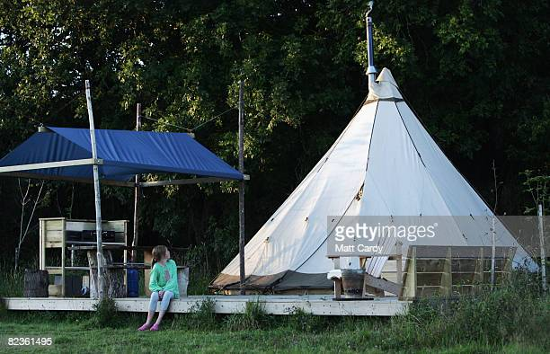 Fenn looks up at the tipi where she is staying with her family at the Fforestcamp on August 15 2008 near Cardigan in Pembrokeshire Wales Despite the...