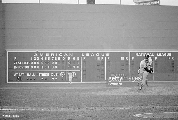 Scoreboard tells the story as Red Sox pitcher Jim Lonborg makes his final pitch to Curt Flood who flied out to Reggie Smith in center field for the...