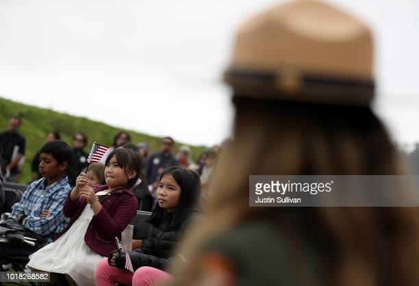 Feona Frej Mojado holds an American flag during a naturalization ceremony for kids between the ages of 612 at Crissy Field near the Golden Gate...