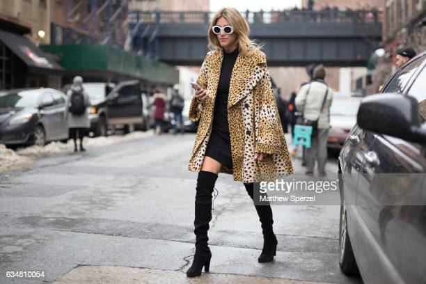 Fer Medina is seen attending TIBI during New York Fashion Week wearing a leopard print fur jacket with kneehigh boots on February 11 2017 in New York...