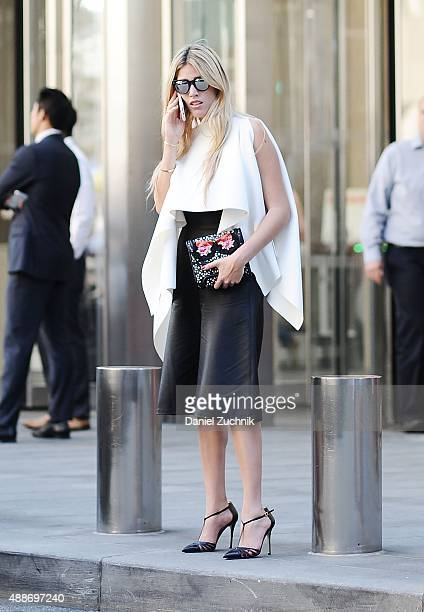 Fer Medina is seen outside the DKNY show wearing Cihuah outfit Sarah Jessica Parker shoes with a Yliana Yepez bag during New York Fashion Show 2016...