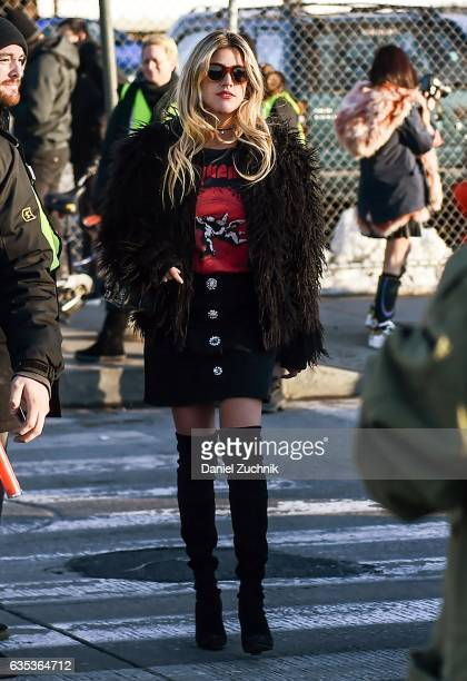 Fer Medina is seen wearing a brown fur coat black skirt and long black boots outside the Coach show during New York Fashion Week Women's Fall/Winter...
