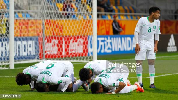 Feras Albrikan of Saudi Arabia celebrates with his team mates after scoring his team's first goal during the 2019 FIFA U-20 World Cup group E match...