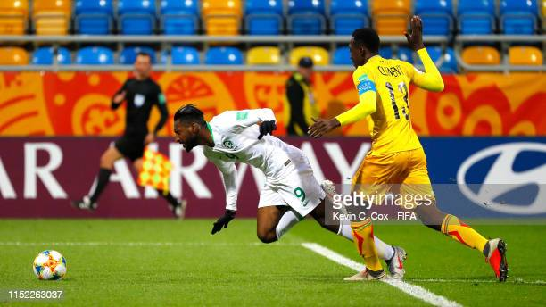 Feras Albrikan of Saudi Arabia is brought down for a penalty by Clement Kanoute of Mali during the 2019 FIFA U-20 World Cup group E match between...