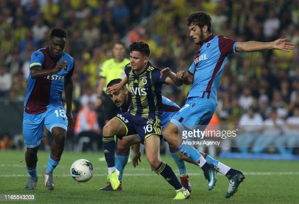 Ferdi Erenay Kadioglu of Fenerbahce in action against Caleb Ekuban of Trabzonspor during Turkish Super Lig week 3 match between Fenerbahce and...