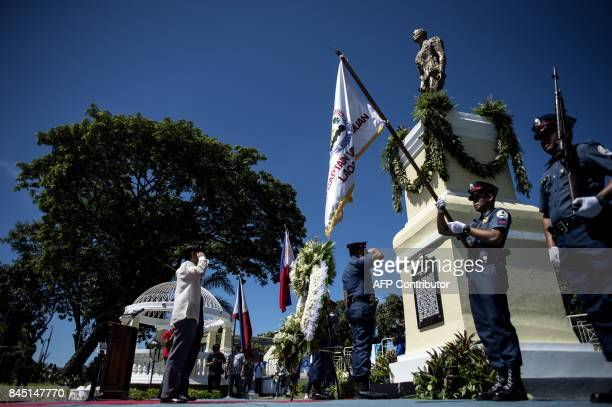 Ferdinand 'Bongbong' Marcos Jnr a former senator and son of the late dictator Ferdinand Marcos salutes in front of a monument dedicated to his father...