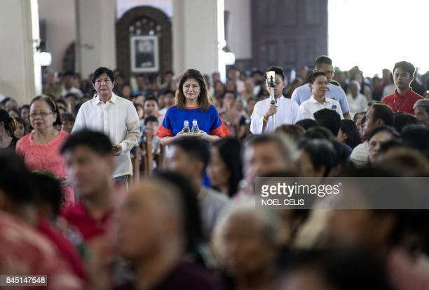 Ferdinand Bongbong Marcos Jnr former senator and son of the late dictator Ferdinand Marcos and his sister Imee attend a mass at the Immaculate...