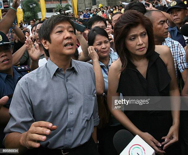 Ferdinand 'BongBong' Marcos Jr and Imee Marcos the children of the late Philippine president Ferdinand Marcos leave the Manila Cathedral after...
