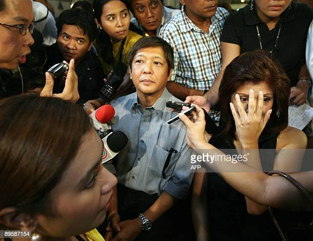 Ferdinand 'BongBong' Marcos Jr and Imee Marcos the children of the late Philippine president Ferdinand Marcos are surrounded by reporters after...