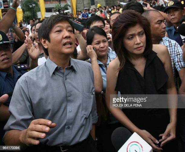 Ferdinand 'Bong-Bong' Marcos Jr. And Imee Marcos , the children of the late Philippine president Ferdinand Marcos, leave the Manila Cathedral after...