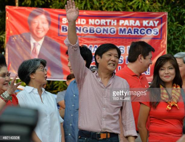 Ferdinand Marcos Jr the son of the late Philipine dictator Ferdinand Marcos waves after announcing his vicepresidential bid at a political rally in...