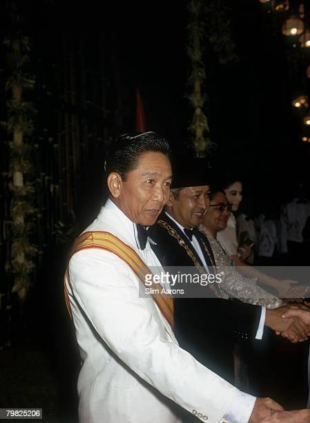 Ferdinand Marcos President of the Philippines and President Suharto of Indonesia attend a state dinner in the Philippines February 1972 They are...
