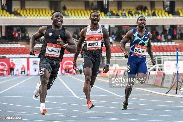 Ferdinand Omanyala of Kenya, Bromell Trayvon of United States and Gatlin Justin of United States, are seen in action during the men's 100m race of...