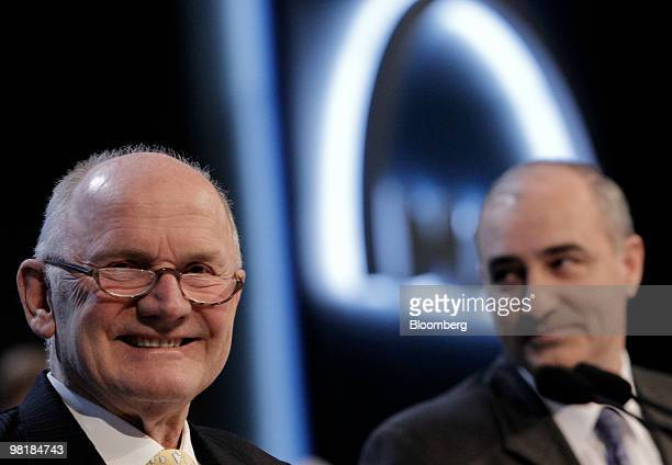 Ferdinand Piech, chairman of the supervisory board of MAN SE, right, and Georg Pachta Reyhofen, the company's chief executive officer, arrive for the...