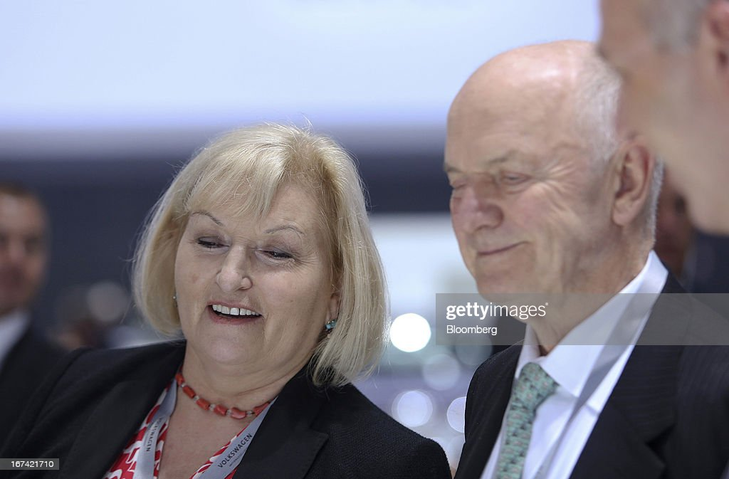 Ferdinand Piech, chairman of Volkswagen AG, right, and his wife Ursula Piech, a member of the executive board at Volkswagen AG, look at a display of cars at the company's annual general meeting (AGM) in Hanover, Germany, on Thursday, April 25, 2013. Volkswagen AG, Europe's biggest automaker, aims to offset plunging European demand this year by rolling out 60 new and updated models, including luxury cruisers like the Bentley Flying Spur. Photographer: Chris Ratcliffe/Bloomberg via Getty Images