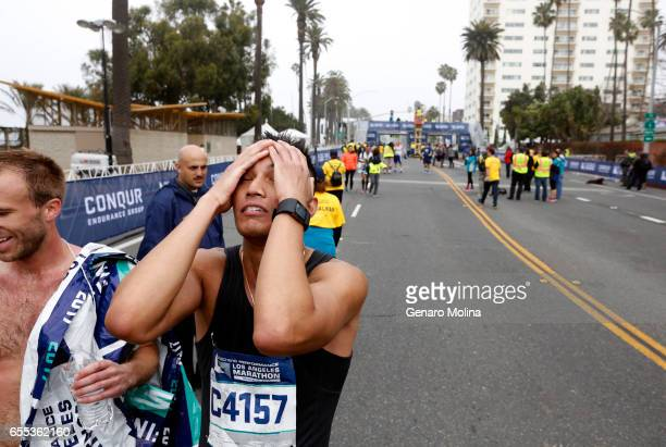 Ferdinel Sabado from San Fernando Valley can't hide his fatigue after completing the 32nd annual Los Angeles Marathon in Santa Monica on March 16 2017