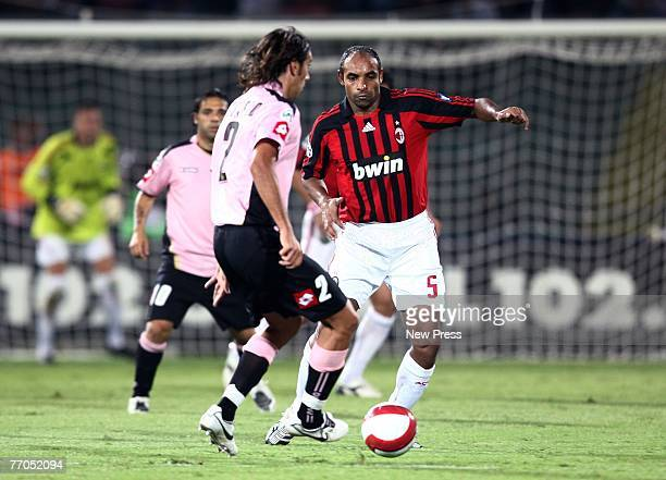 Fereira da Rosa Emerson of AC Milan in action against Cristian Zaccardo of Palermo during the Italian serie A football match between Palermo and AC...