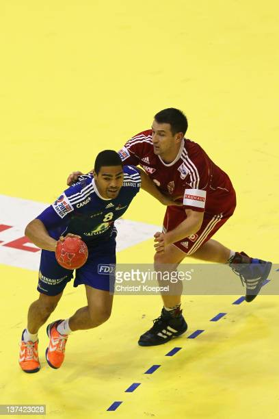 Ferenc Ilyes of Hungary defends against Daniel Narcisse of France during the Men's European Handball Championship group C match between France and...