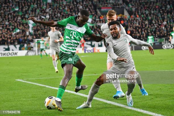 Ferencvaros' Norwegian midfielder Tokmac Nguen and Ludogorets Razgrad's Brazilian defender Cicinho vie for the ball during the UEFA Europa League...