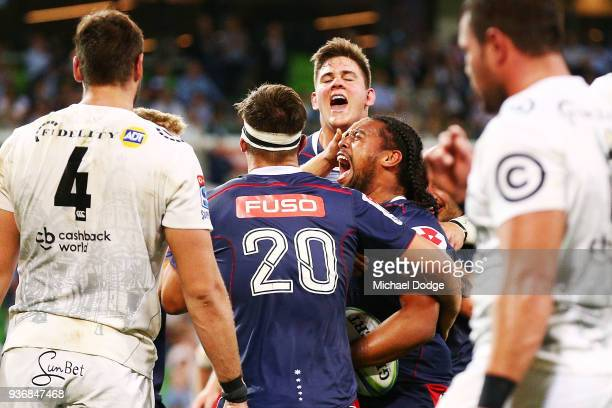 Fereti Saaga of the Rebels celebrates a try during the round six Super Rugby match between the Melbourne Rebels and the Sharks at AAMI Park on March...
