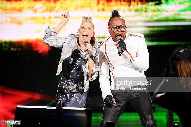 Fergie and apldeap of the Black Eyed Peas perform onstage during CHASE Presents The Black Eyed Peas and Friends 'Concert 4 NYC' benefiting the Robin...