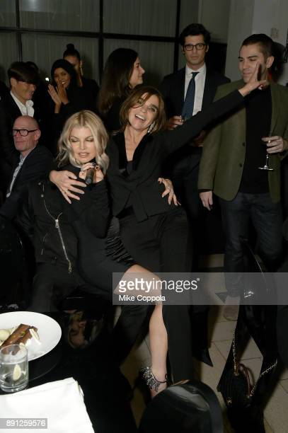 Fergie and Carine Roitfeld attend the CR Fashion Book Celebrating launch of CR Girls 2018 with Technogym at Spring Place on December 12 2017 in New...