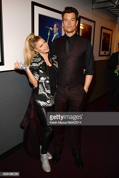 Fergie and Josh Duhamel attend the 2014 American Music Awards at Nokia Theatre LA Live on November 23 2014 in Los Angeles California