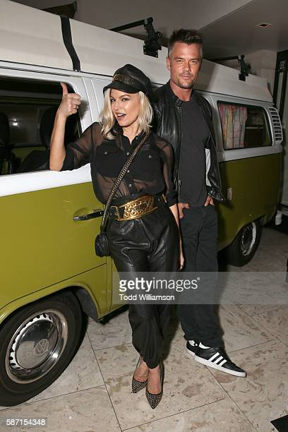 Fergie and Josh Duhamel pose with the VW Van from Orion Pictures' Spaceman at the Premiere at the London Hotel on August 7 2016 in Los Angeles...