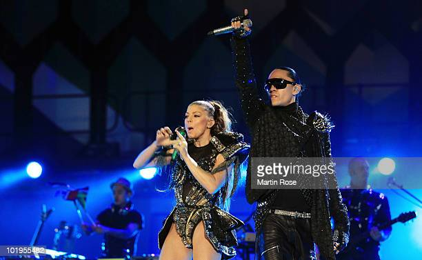 Fergie and Taboo of Black Eyed Peas perform a song during the kick-off celebration concert for the 2010 FIFA World Cup at the Orlando Stadium on June...