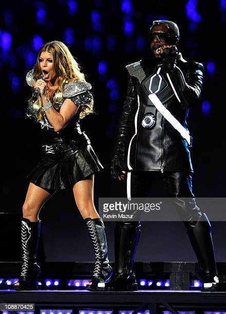 Fergie and will.i.am of The Black Eyed Peas perform during the Bridgestone Super Bowl XLV Halftime Show at Dallas Cowboys Stadium on February 6, 2011...