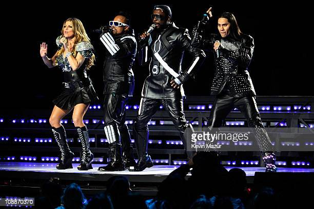 Fergie, apl.de.ap, will.i.am and Taboo of The Black Eyed Peas perform during the Bridgestone Super Bowl XLV Halftime Show at Dallas Cowboys Stadium...