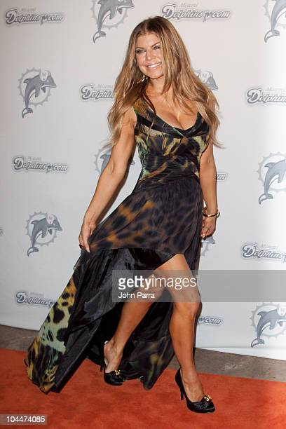 Fergie arrives on the Orange Carpet for the Miami Dolphins versus New York Jets game at Sun Life Stadium on September 26, 2010 in Miami, Florida.