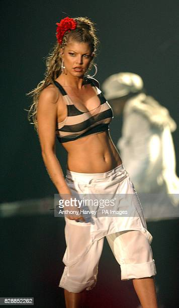 Fergie from The Black Eyed Peas perform on stage during the MTV Europe Music Awards 2003 at Western Harbour in Leith Edinburgh