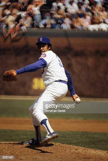 Fergie Jenkins of the Chicago Cubs winds back to pitch in a game during the 1983 season at Wrigley Field in Chicago Illinois
