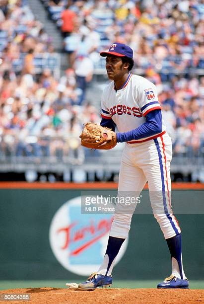 Fergie Jenkins of the Texas Rangers waits for a pitch sign during a game at The Ballpark in Arlington in Arlington Texas Jenkins played for the...