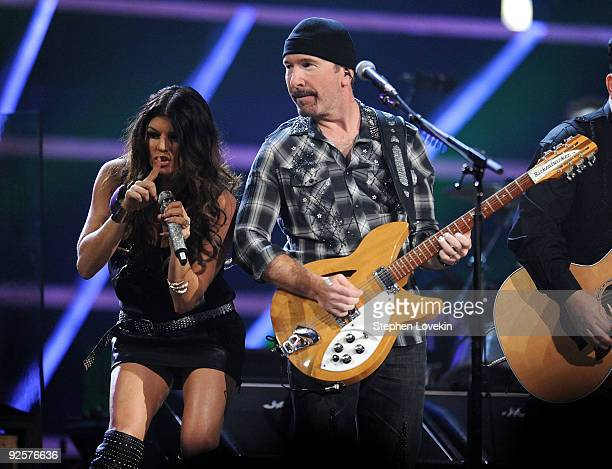 Fergie of Black Eyed Peas and The Edge of U2 perform onstage at the 25th Anniversary Rock Roll Hall of Fame Concert at Madison Square Garden on...