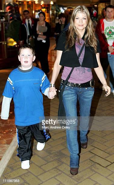Fergie of Black Eyed Peas with Patrick Hennessey, nephew of contest winner Christi Ward